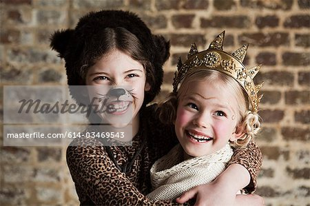 Young girls dressed up as cat and queen Stock Photo - Premium Royalty-Free, Image code: 614-03469543