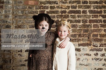 Young girls dressed up as cat and queen Stock Photo - Premium Royalty-Free, Image code: 614-03469560