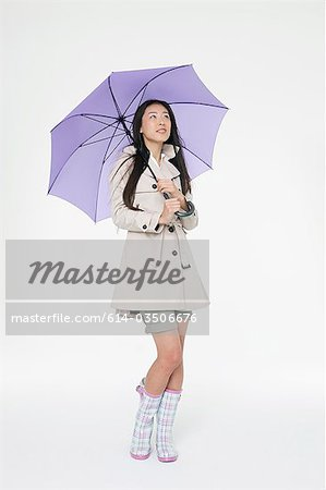 Woman with umbrella Stock Photo - Premium Royalty-Free, Image code: 614-03506676