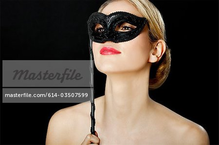 Young blonde woman wearing with black mask Stock Photo - Premium Royalty-Free, Image code: 614-03507599