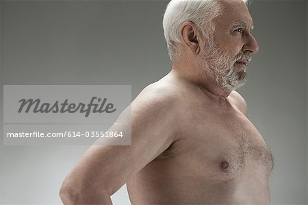 Bare chested senior man Stock Photo - Premium Royalty-Free, Image code: 614-03551864