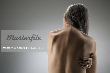 Topless senior woman, rear view Stock Photo - Premium Royalty-Free, Image code: 614-03551881