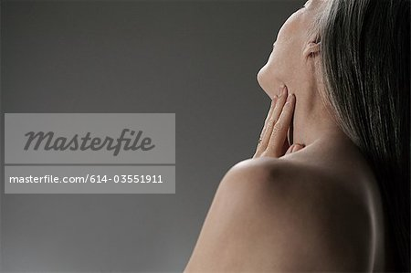 Topless senior woman, rear view Stock Photo - Premium Royalty-Free, Image code: 614-03551911
