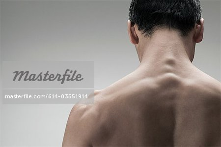 Muscular mature man, rear view Stock Photo - Premium Royalty-Free, Image code: 614-03551914