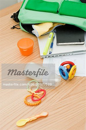 Baby and work equipment coming out of bag Stock Photo - Premium Royalty-Free, Image code: 614-03577020