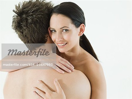 Nude couple embracing Stock Photo - Premium Royalty-Free, Image code: 614-03647993