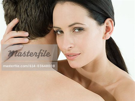 Nude couple embracing Stock Photo - Premium Royalty-Free, Image code: 614-03648008