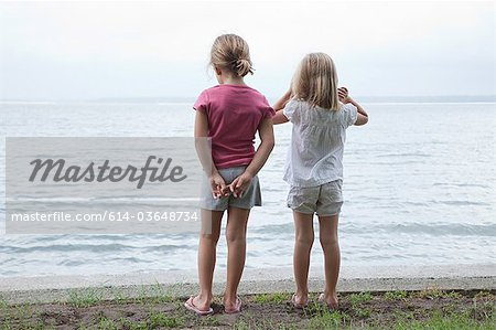 Two little girls by the sea Stock Photo - Premium Royalty-Free, Image code: 614-03648734