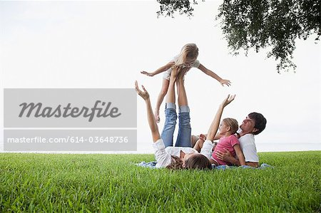 Girl balancing on feet of mother Stock Photo - Premium Royalty-Free, Image code: 614-03648736