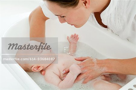 Mother bathing baby Stock Photo - Premium Royalty-Free, Image code: 614-03684087