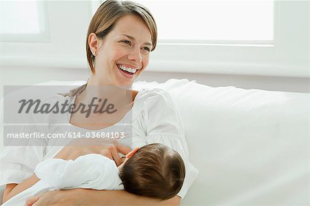 Mother breast feeding baby Stock Photo - Premium Royalty-Free, Image code: 614-03684103