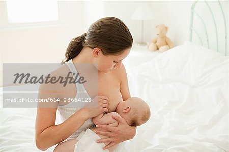 Mother breast feeding baby son Stock Photo - Premium Royalty-Free, Image code: 614-03684129