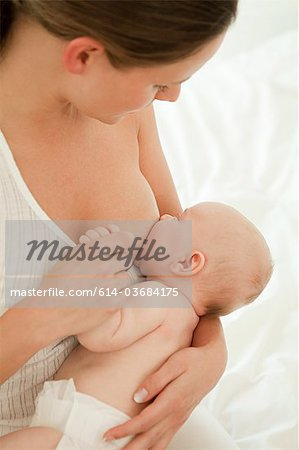 Mother breast feeding baby son Stock Photo - Premium Royalty-Free, Image code: 614-03684175