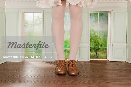 Legs of giant woman in tiny room Stock Photo - Premium Royalty-Free, Image code: 614-03684592