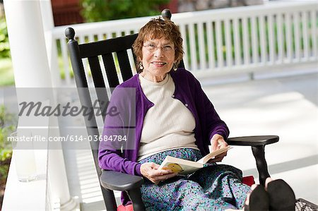 Senior woman with book Stock Photo - Premium Royalty-Free, Image code: 614-03684784