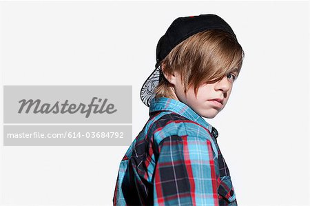 Teenage boy looking over shoulder Stock Photo - Premium Royalty-Free, Image code: 614-03684792