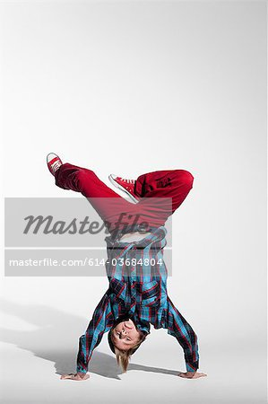 Teenage boy doing a handstand Stock Photo - Premium Royalty-Free, Image code: 614-03684804