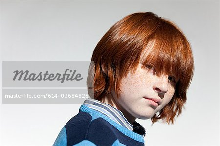 Portrait of boy with red hair Stock Photo - Premium Royalty-Free, Image code: 614-03684828