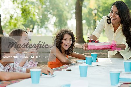 Children at birthday party with birthday cake Stock Photo - Premium Royalty-Free, Image code: 614-03697225