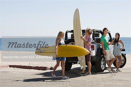 Friends by vehicle with surfboards Stock Photo - Premium Royalty-Free, Image code: 614-03697647
