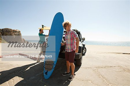 Two young men with surfboards Stock Photo - Premium Royalty-Free, Image code: 614-03697649