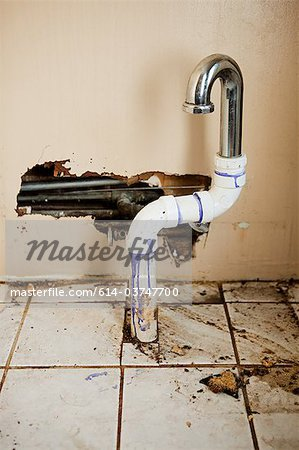 Damaged sink pipe Stock Photo - Premium Royalty-Free, Image code: 614-03747700