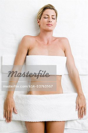 Young woman having body treatment Stock Photo - Premium Royalty-Free, Image code: 614-03763557