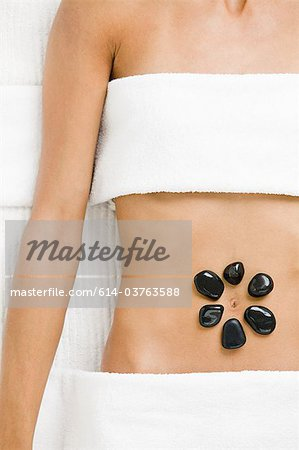 Young woman having hot stone therapy Stock Photo - Premium Royalty-Free, Image code: 614-03763588