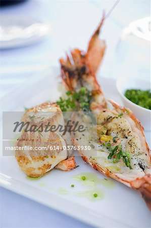 Lobster tail and scallops Stock Photo - Premium Royalty-Free, Image code: 614-03763930