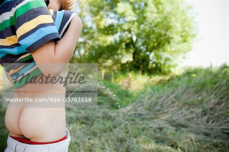 Boy urinating Stock Photo - Premium Royalty-Free, Image code: 614-03783558