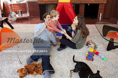 Family playing in living room Stock Photo - Premium Royalty-Free, Image code: 614-03818600