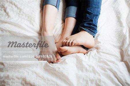 Two teenage girls playing footsie