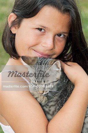 Girl holding pet cat, portrait Stock Photo - Premium Royalty-Free, Image code: 614-03903189