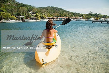 Young woman kayaking in sea Stock Photo - Premium Royalty-Free, Image code: 614-05556891
