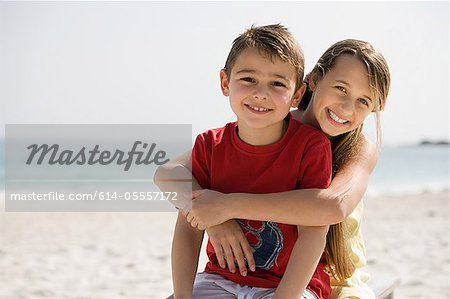 Brother and sister embracing on a beach Stock Photo - Premium Royalty-Free, Image code: 614-05557172