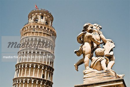 Cherub Statue and Leaning Tower Of Pisa, Pisa, Tuscany, Italy Stock Photo - Premium Royalty-Free, Image code: 614-05650787