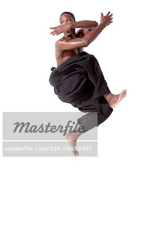 Dancer in mid air pose Stock Photo - Premium Royalty-Free, Image code: 614-05650897