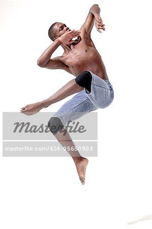Young man in mid air Stock Photo - Premium Royalty-Free, Image code: 614-05650903