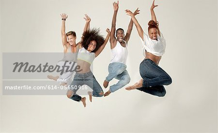 Four young adults jumping in the air with joy Stock Photo - Premium Royalty-Free, Image code: 614-05650916