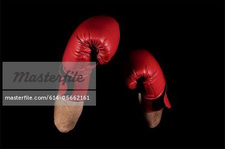 Close up of boxers' arms and gloves Stock Photo - Premium Royalty-Free, Image code: 614-05662161