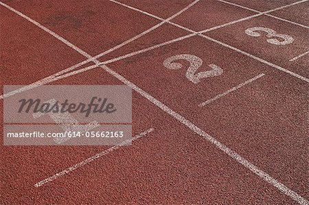 Close up of running track start lines Stock Photo - Premium Royalty-Free, Image code: 614-05662163