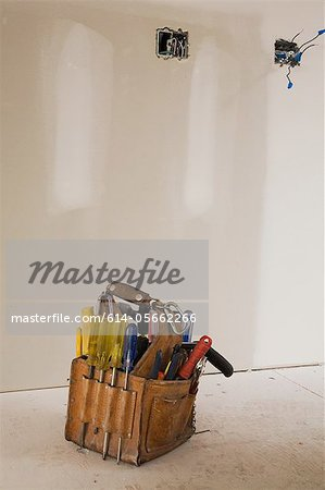 Tool bag on the floor of unfinished room Stock Photo - Premium Royalty-Free, Image code: 614-05662266
