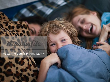 Mother and children in a tent Stock Photo - Premium Royalty-Free, Image code: 614-05792047