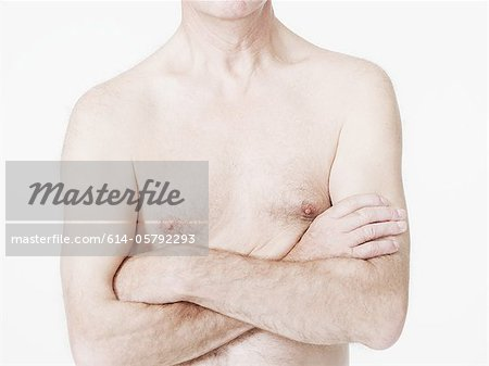 Man with bare chest and arms crossed Stock Photo - Premium Royalty-Free, Image code: 614-05792293
