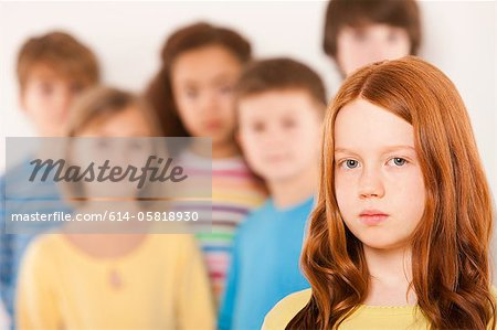Girl separate from other children Stock Photo - Premium Royalty-Free, Image code: 614-05818930