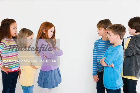 Girls and boys confronting each other Stock Photo - Premium Royalty-Free, Image code: 614-05818944