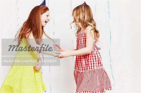 Girls dancing at party Stock Photo - Premium Royalty-Free, Image code: 614-05819064