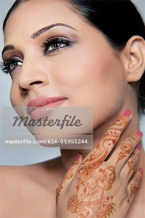 Beautiful woman with mehndi Stock Photo - Premium Royalty-Free, Image code: 614-05955244