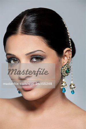 Portrait of a beautiful woman with earrings Stock Photo - Premium Royalty-Free, Image code: 614-05955248