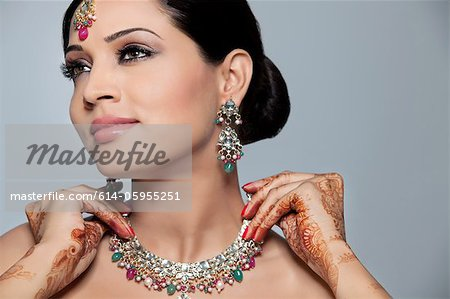 Beautiful woman wearing a necklace Stock Photo - Premium Royalty-Free, Image code: 614-05955251